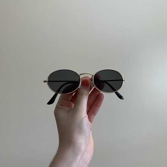 Accessories - black sunglasses with a golden frame